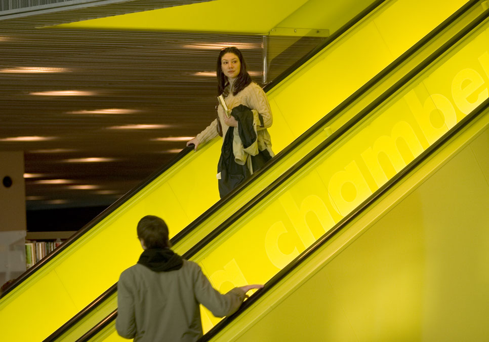 Patrons on the escalator at the Central Library