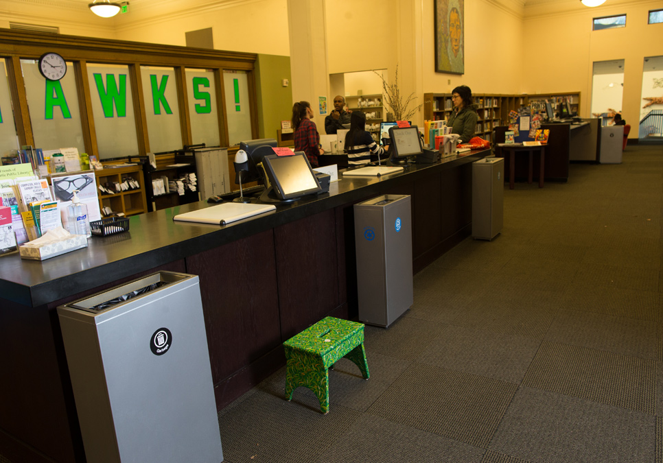 Library staff at the service desk area at the Douglass-Truth Branch