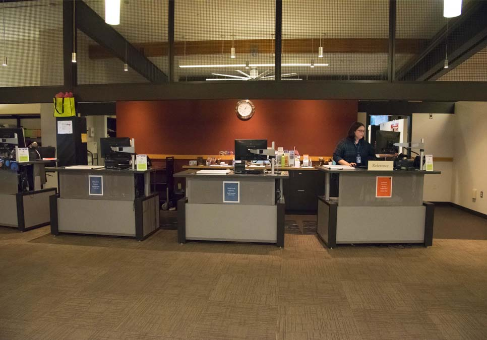 Library staff at the service desk area at the Northeast Branch