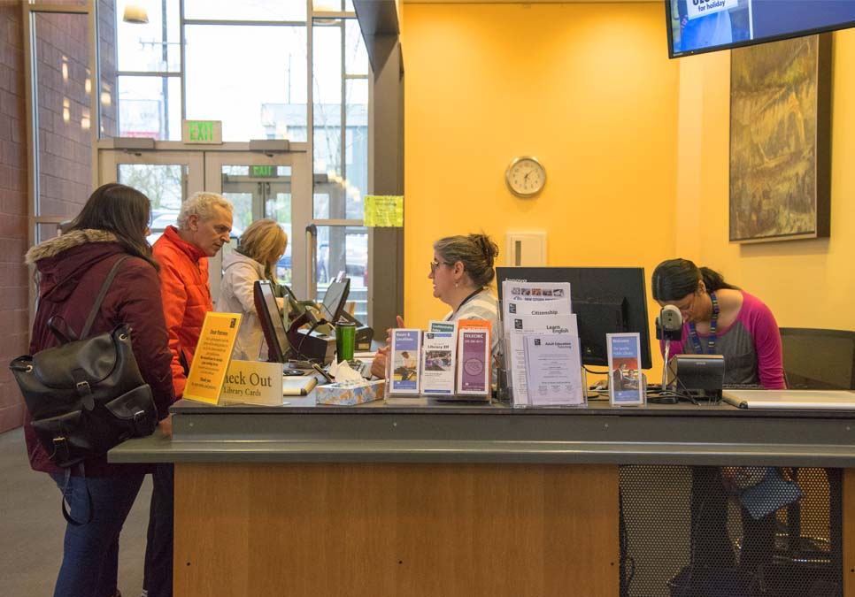 Library patrons at service desk area at the Northgate Branch
