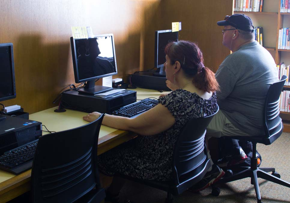 Library patrons using public computers at the University Branch