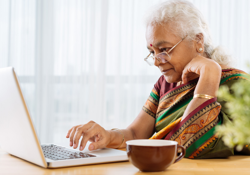 Older adult using laptop